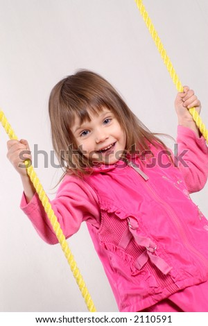 little girl on the swing - stock photo
