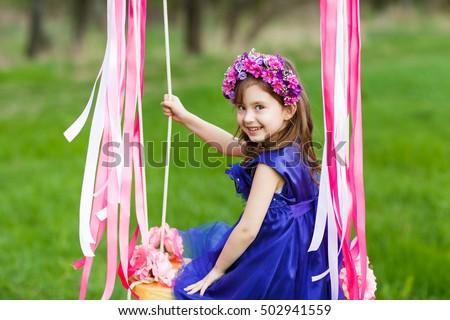 royalty free little girl on the swing little girl 439181032 stock