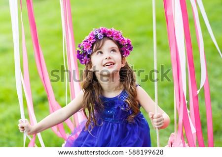 royalty free little girl on the swing little girl 424497853 stock