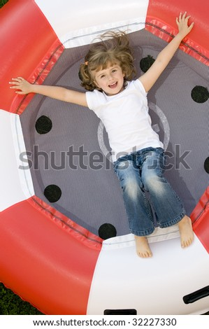 Little girl on trampoline