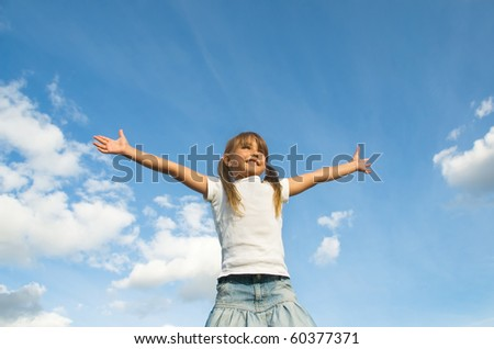 Little girl outdoor standing high with her hand outstretched