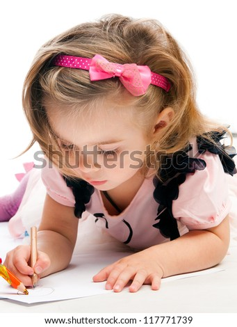 Little girl painting on a white background