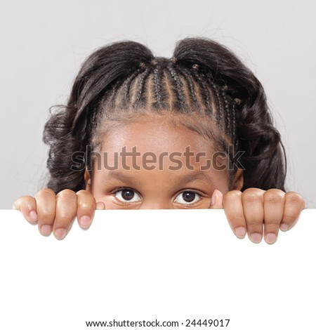 Little girl peeking from behind copy space