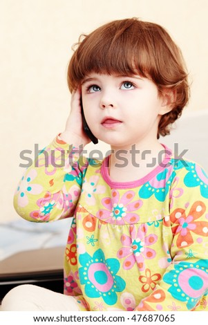Little girl phoning with cell phone