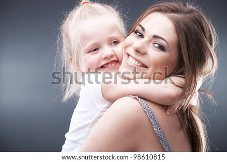 little girl play with mother