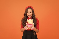 Little girl play with soft toy teddy bear. Child care. Childhood memories. Emotional intellect. Lovely child. Lovely small girl smiling happy face hold toy. Happy childhood. Imaginary friend