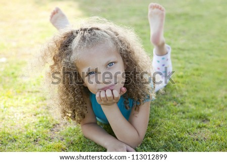 Little girl playing at the park