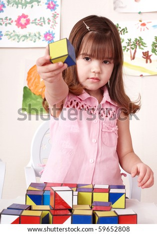 Little girl playing  block at home. - stock photo