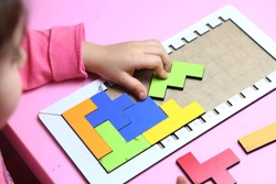 little girl playing colorful intelligence game
