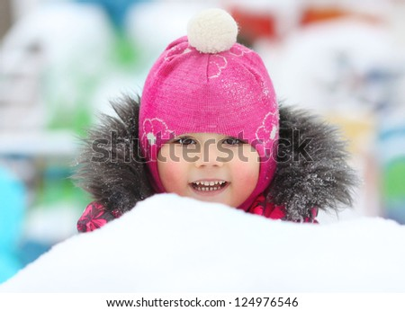 little girl playing in the snow, portrait