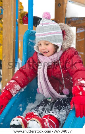 Little girl playing in winter time.