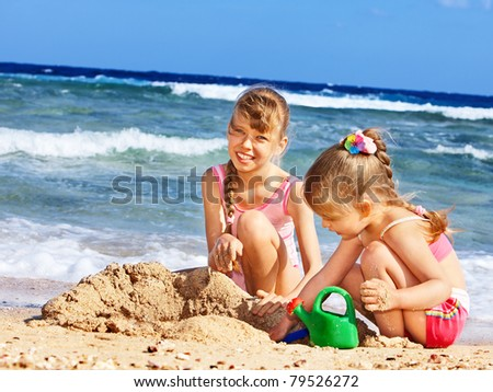Little girl  playing on  beach.