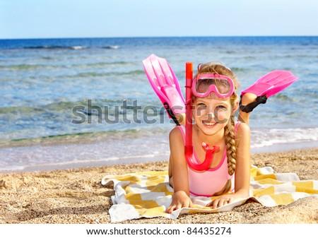 Little girl  playing on  beach.
