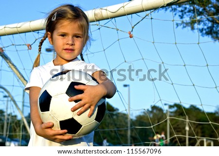 Little girl playing soccer