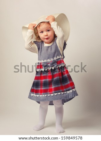 Little girl playing the fashion isolated on cream-colored