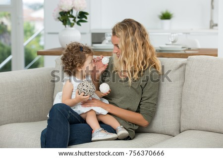 little girl playing with au pair girl