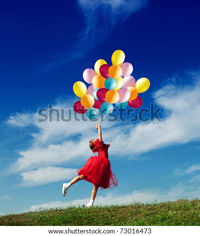 stock photo : Little girl playing with balloons