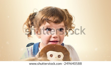 Little girl playing with stuffed animal