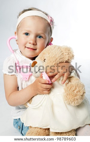 little girl plays doctor