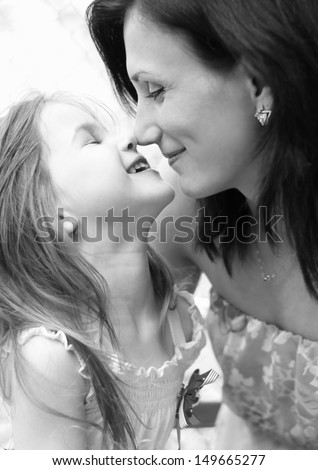 little girl plays with her mother