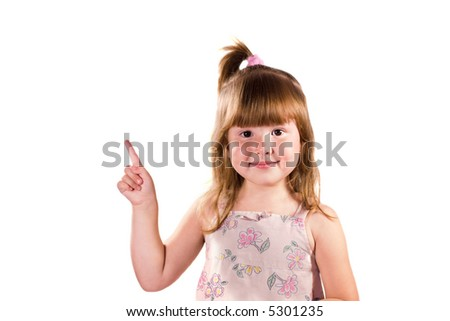 Little girl pointig up looking at you with smile isolated on white