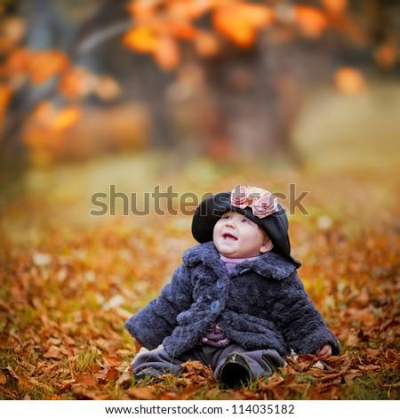 Little girl portrait in autumn park