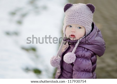 Little girl portrait on winter day in city