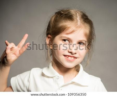 Little girl posing for her first model portfolio