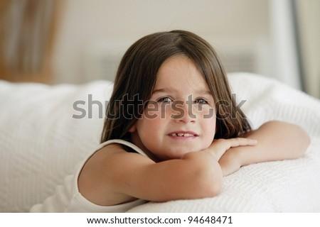 little girl posing on the sofa