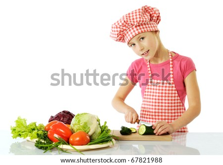 Little girl preparing salad