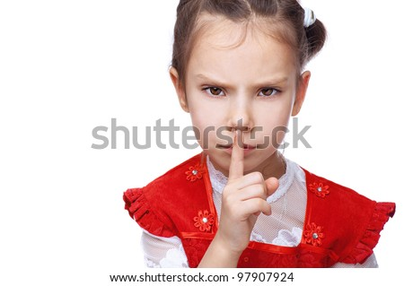 Little girl put her finger to her lips as sign of peace, isolated on white background.