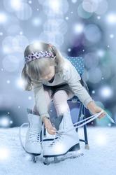 little girl puts on the skates