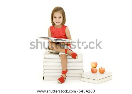 little girl reading a book isolated on white