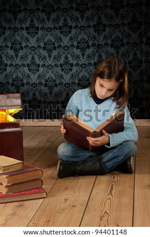little girl reading a book with a retro background