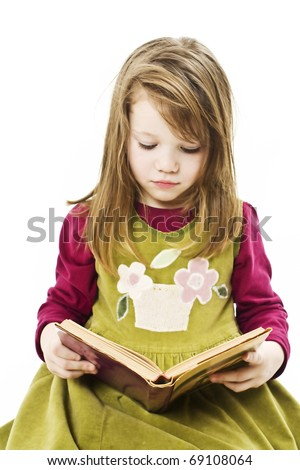 Little girl reading book, isolated on white background