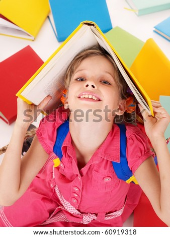 Little girl reading open  book on table. Isolated.