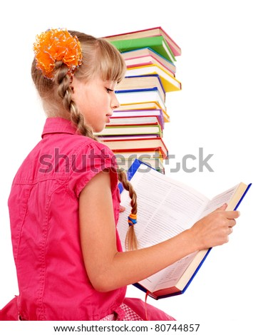 Little girl reading open  book on table. Isolated. - stock photo