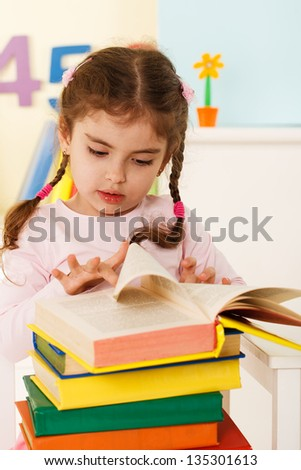 little girl reads,preschool education