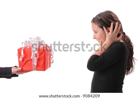 Little girl receiving a gift isolated against white background