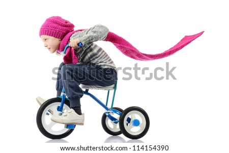 Little girl rides a bicycle on white background