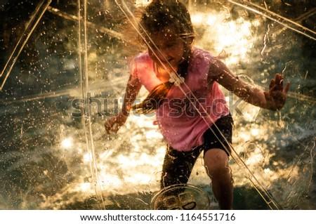 little girl running around in a hot air balloon #1164551716