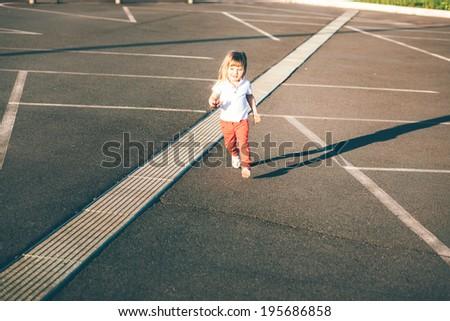 Little girl running away on the road #195686858