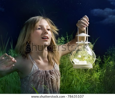 stock photo : Little Girl Running on a green field. Mystical Night