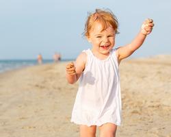 Little girl running on the beach
