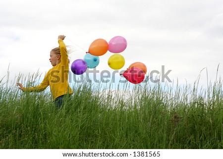 Little girl running with balloons