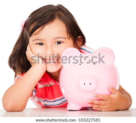 Little girl saving money in a piggybank - isolated over a white background - stock photo