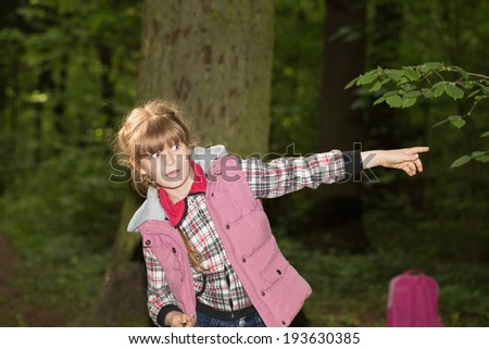 Little girl scared in the woods