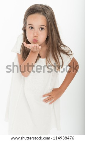 Little girl sending a kiss with her hand