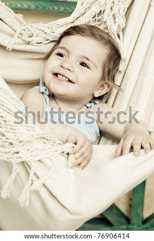 little girl shakes in a soft hammock