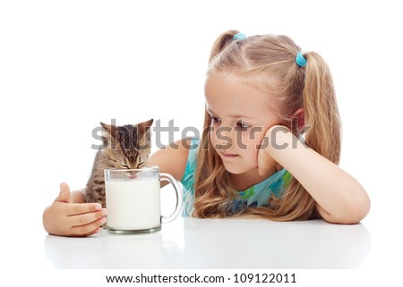 Little girl sharing milk with her kitten - animal care concept, isolated with reflections